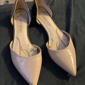 Nude and black flats